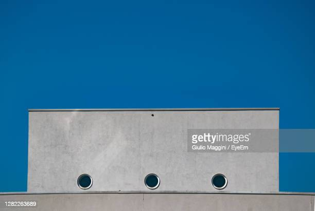 low angle view of building against blue sky - treviso italy stock pictures, royalty-free photos & images