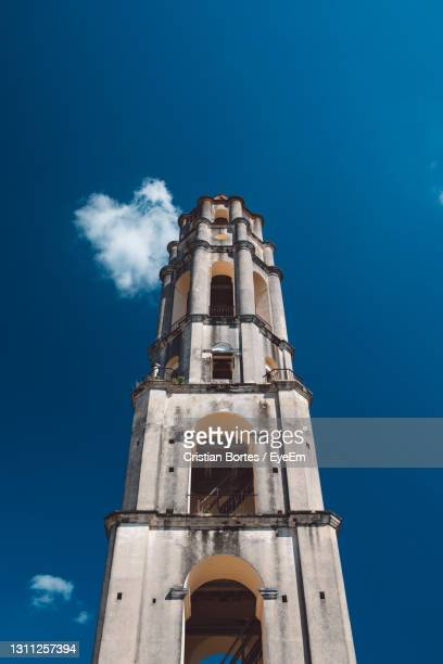 low angle view of building against blue sky - bortes stock pictures, royalty-free photos & images