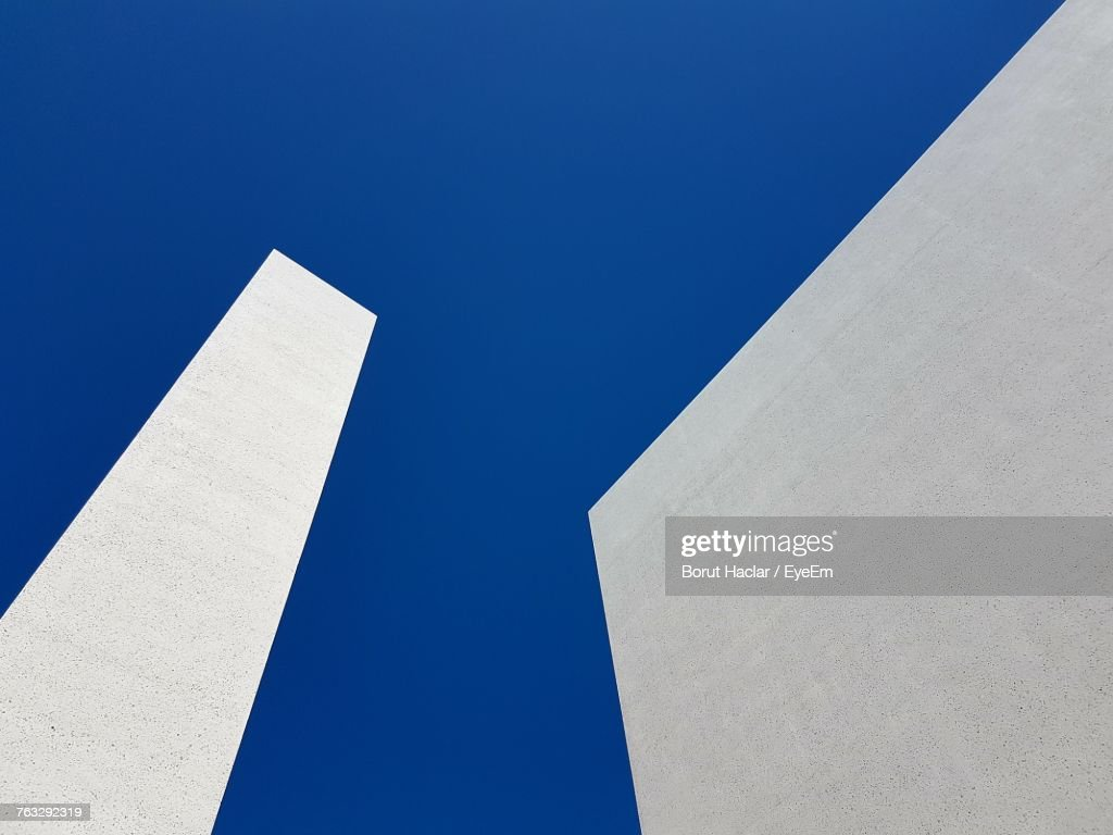 Low Angle View Of Building Against Blue Sky : Stock Photo