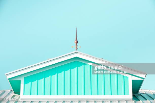 low angle view of building against clear blue sky - fort myers beach stock pictures, royalty-free photos & images
