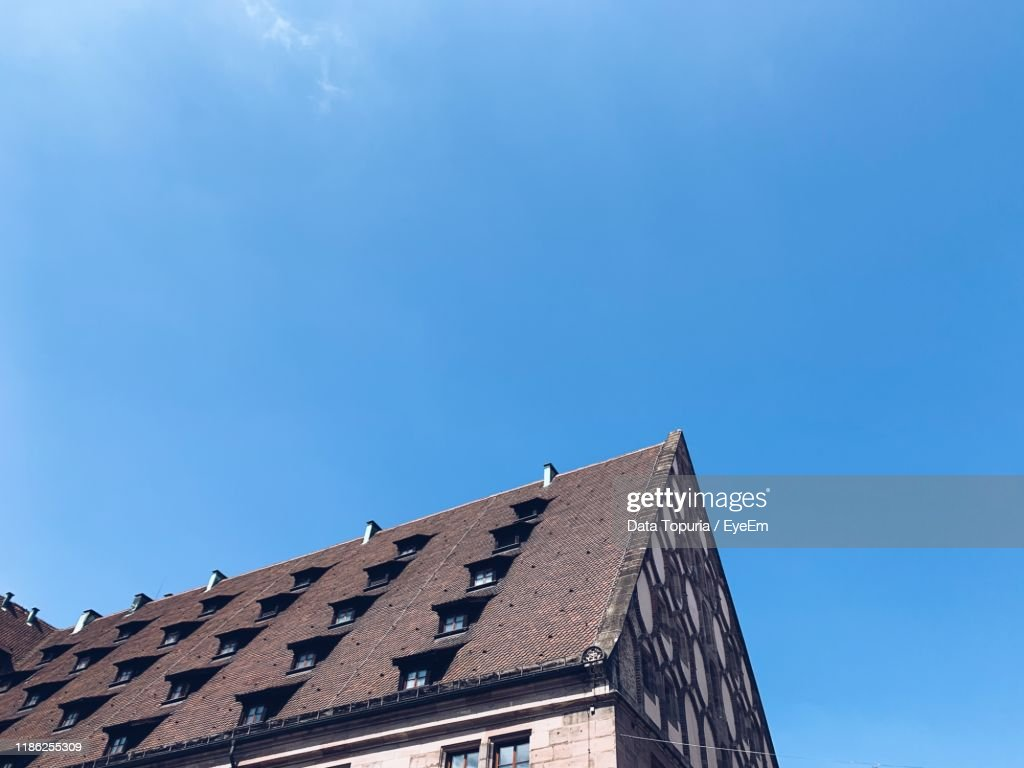 Low Angle View Of Building Against Clear Blue Sky : Stock Photo