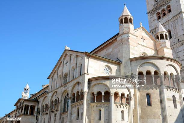low angle view of building against clear blue sky - enrico aliberti stock-fotos und bilder