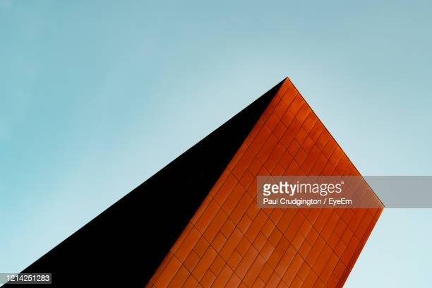 low angle view of building against clear blue sky - triangle shape stock pictures, royalty-free photos & images
