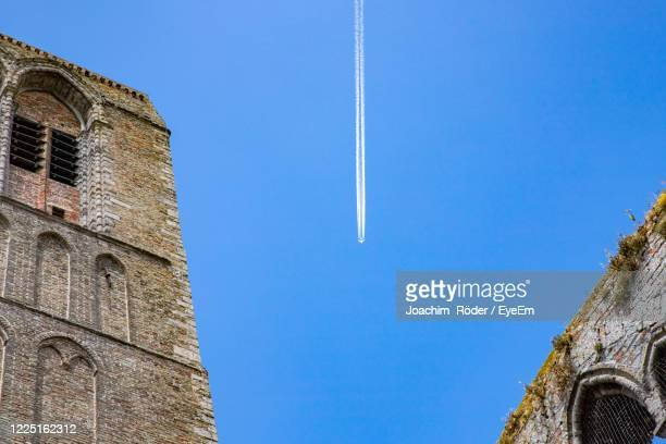 low angle view of building against clear blue sky - damme stock pictures, royalty-free photos & images