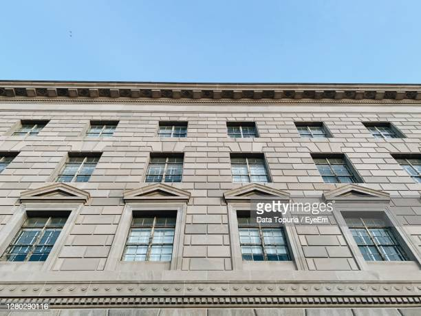 low angle view of building against clear blue sky - data topuria stock pictures, royalty-free photos & images