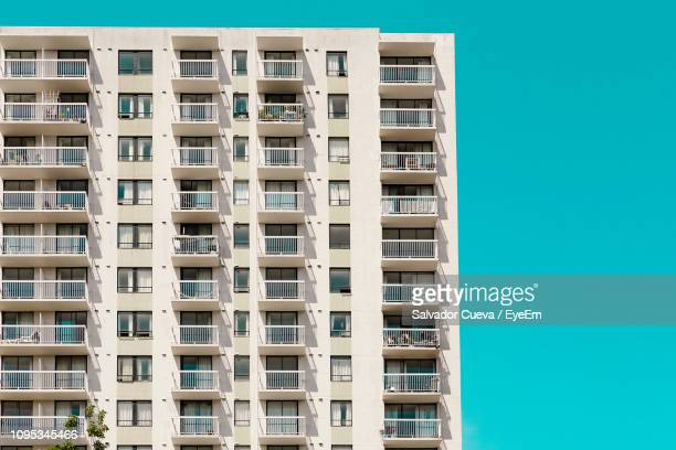 low angle view of building against clear sky - apartment balcony stock pictures, royalty-free photos & images