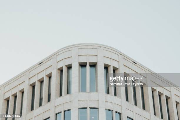 low angle view of building against clear sky - neo classical stock pictures, royalty-free photos & images