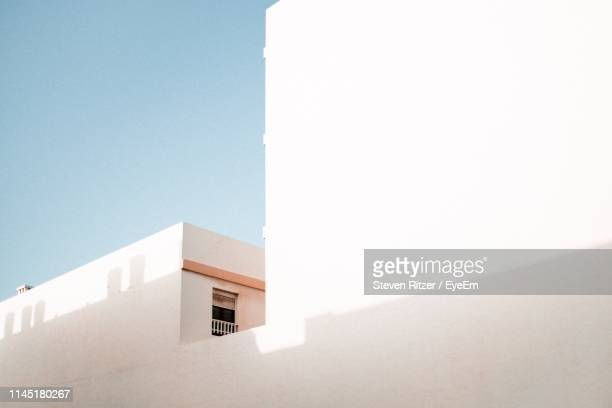 low angle view of building against clear sky - arrecife stock photos and pictures