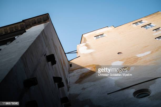 low angle view of building against clear sky - christian soldatke stock pictures, royalty-free photos & images