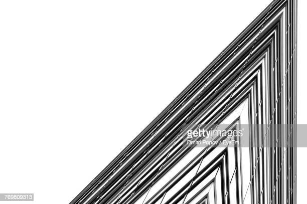 low angle view of building against clear sky - architectural feature stock pictures, royalty-free photos & images