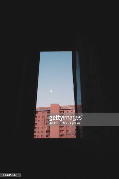 low angle view of building against clear sky seen through window - sibiu stock photos and pictures