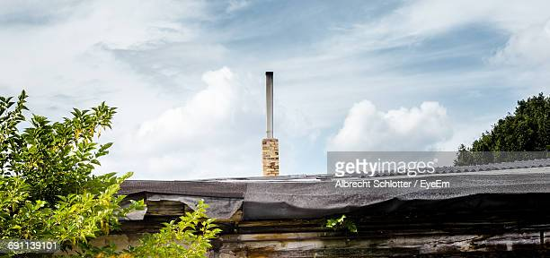 low angle view of building against cloudy sky - albrecht schlotter stock photos and pictures