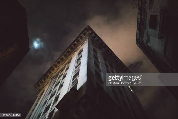low angle view of building against sky at night - bortes stockfoto's en -beelden