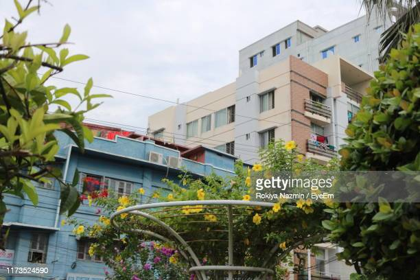 low angle view of building against sky - khulna stock photos and pictures