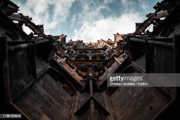 low angle view of building against sky - christian soldatke stock pictures, royalty-free photos & images