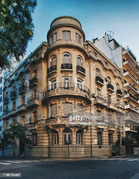 low angle view of building against sky - buenos aires photos et images de collection