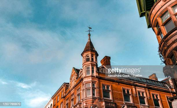 low angle view of building against sky - the past stock pictures, royalty-free photos & images