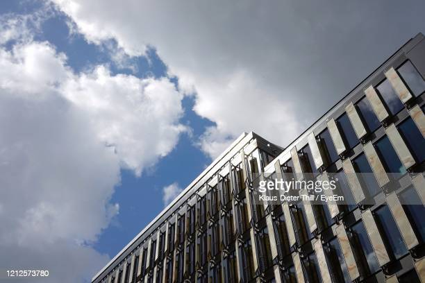 low angle view of building against sky - klaus-dieter thill stock-fotos und bilder