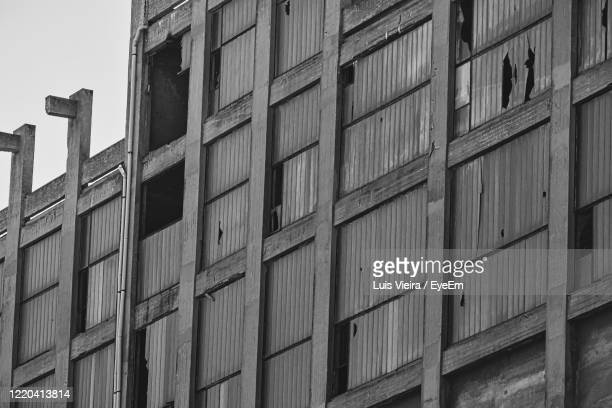 low angle view of building against sky - ghetto trash stock pictures, royalty-free photos & images