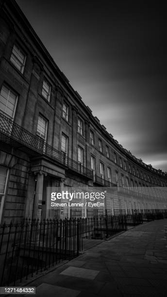 low angle view of building against sky - black and white stock pictures, royalty-free photos & images
