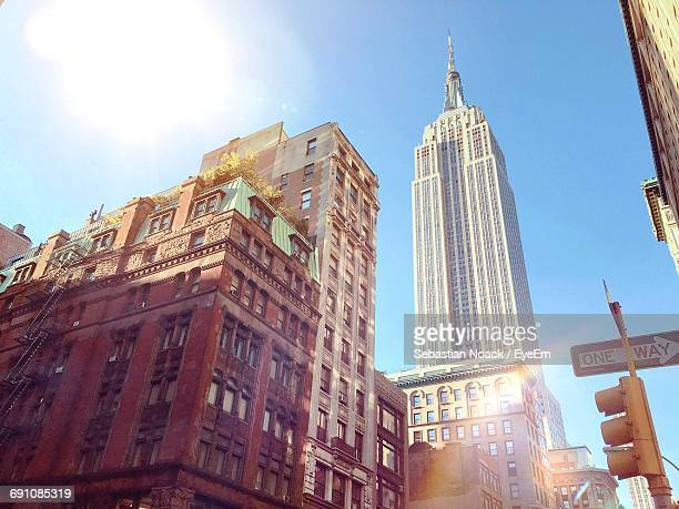 low angle view of building against sky - empire state building stock pictures, royalty-free photos & images