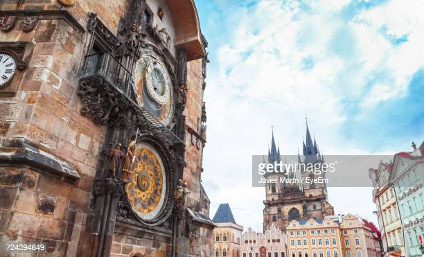 low angle view of building against sky - astronomical clock prague stock pictures, royalty-free photos & images