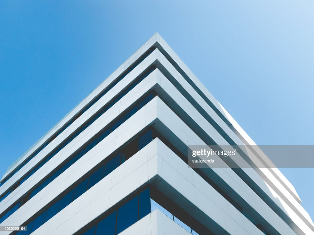 Low angle view of building corner against clear blue sky : Stock Photo