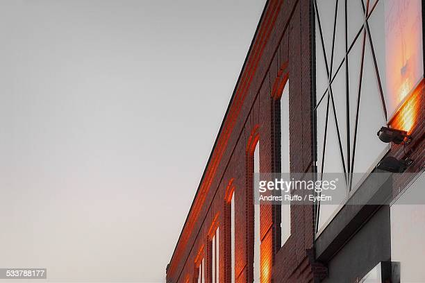 low angle view of building lit up at dusk - andres ruffo stock pictures, royalty-free photos & images