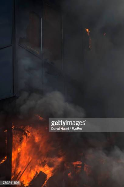 Low Angle View Of Building On Fire