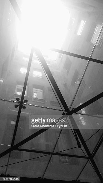 Low Angle View Of Building Seen Through Glass
