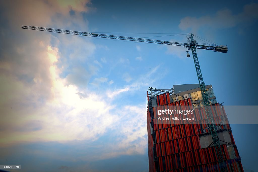 Low Angle View Of Building Under Construction Against Blue Sky : Stock Photo
