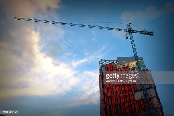 Low Angle View Of Building Under Construction Against Blue Sky
