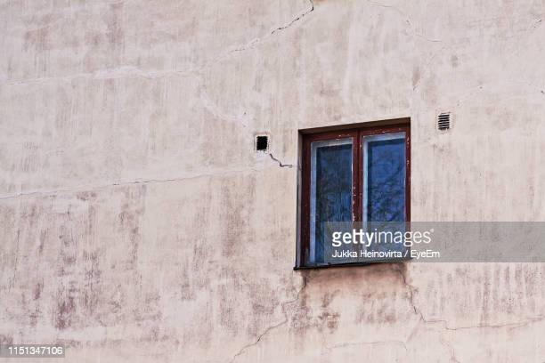 low angle view of building window - heinovirta stock photos and pictures