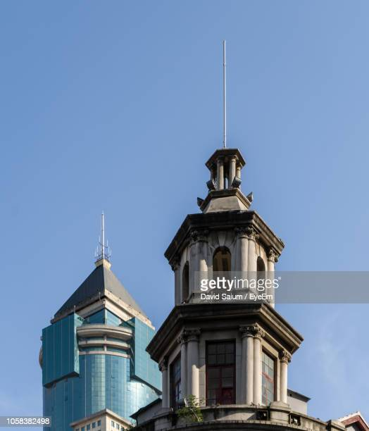 low angle view of buildings against blue sky - wuhan ストックフォトと画像