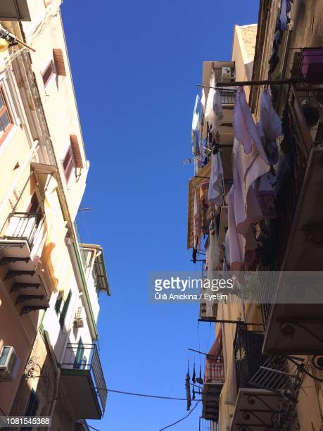 low angle view of buildings against blue sky - southern europe stock pictures, royalty-free photos & images