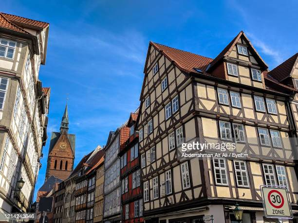 low angle view of buildings against blue sky - hanover germany stock pictures, royalty-free photos & images