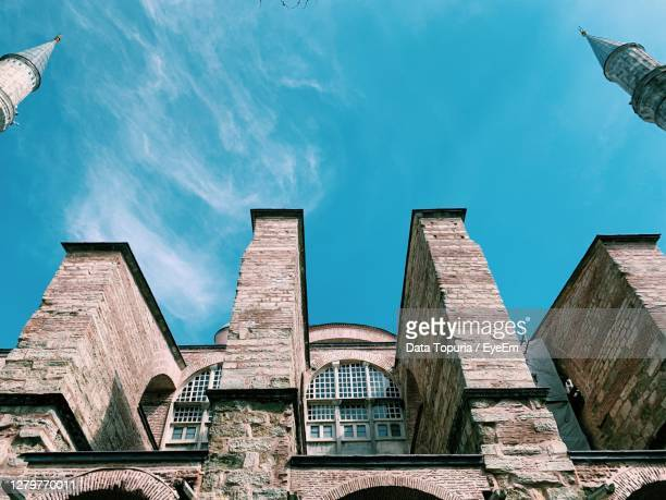 low angle view of buildings against blue sky - data topuria stock pictures, royalty-free photos & images