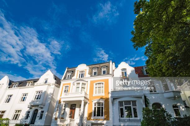 low angle view of buildings against blue sky - hamburg germany stock pictures, royalty-free photos & images