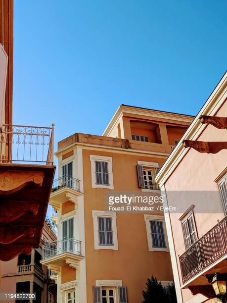 low angle view of buildings against clear blue sky - fouad el-khabbaz stock pictures, royalty-free photos & images