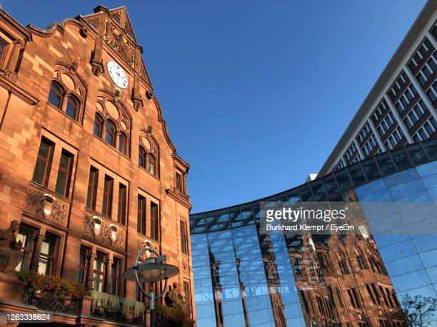 low angle view of buildings against clear blue sky - dortmund city stock pictures, royalty-free photos & images