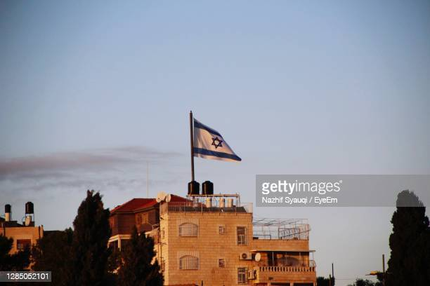 low angle view of buildings against clear blue sky - israel stock pictures, royalty-free photos & images