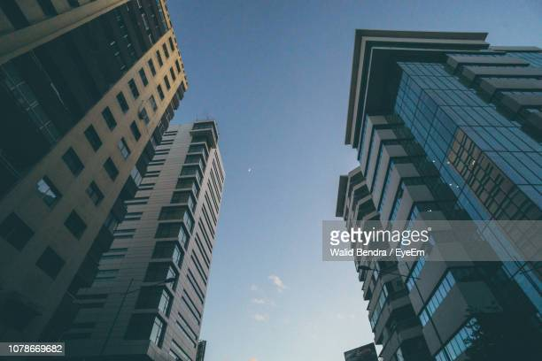 low angle view of buildings against clear sky in city - casablanca photos et images de collection