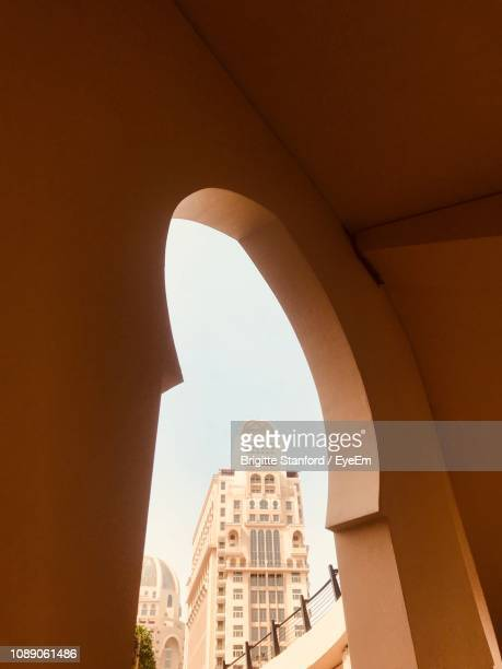 low angle view of buildings against clear sky - doha stockfoto's en -beelden
