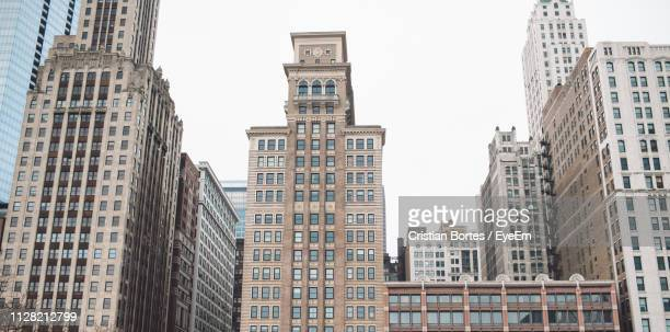 low angle view of buildings against clear sky - bortes stockfoto's en -beelden