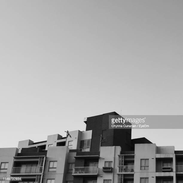 low angle view of buildings against clear sky - chynna stock pictures, royalty-free photos & images