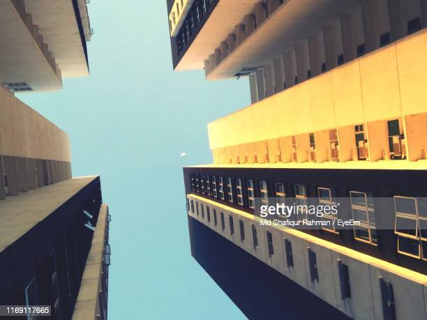 low angle view of buildings against clear sky - blue balls pics stock pictures, royalty-free photos & images