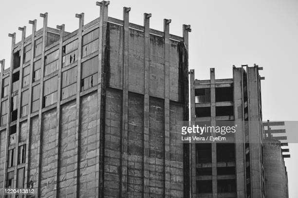 low angle view of buildings against clear sky - ghetto trash stock pictures, royalty-free photos & images