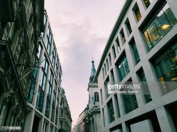 low angle view of buildings against cloudy sky - data topuria stock pictures, royalty-free photos & images