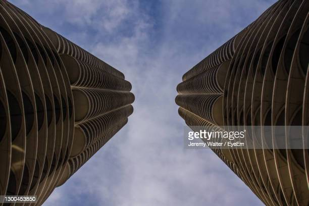 low angle view of buildings against cloudy sky - eyeem jeremy walter stock pictures, royalty-free photos & images