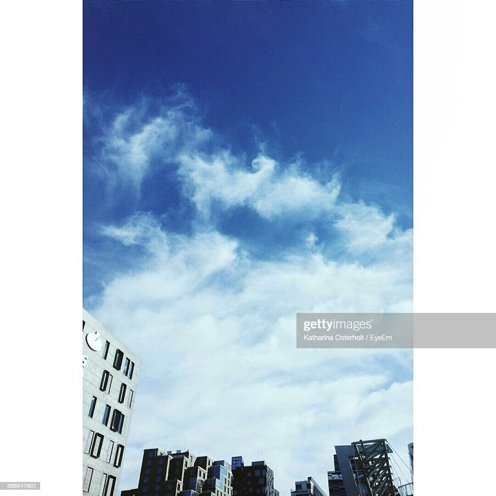 Low Angle View Of Buildings Against Cloudy Sky : Stock Photo